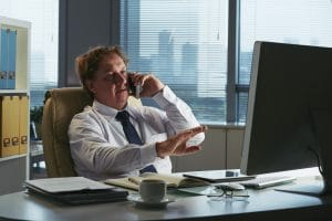 businessman receiving reference check phone call
