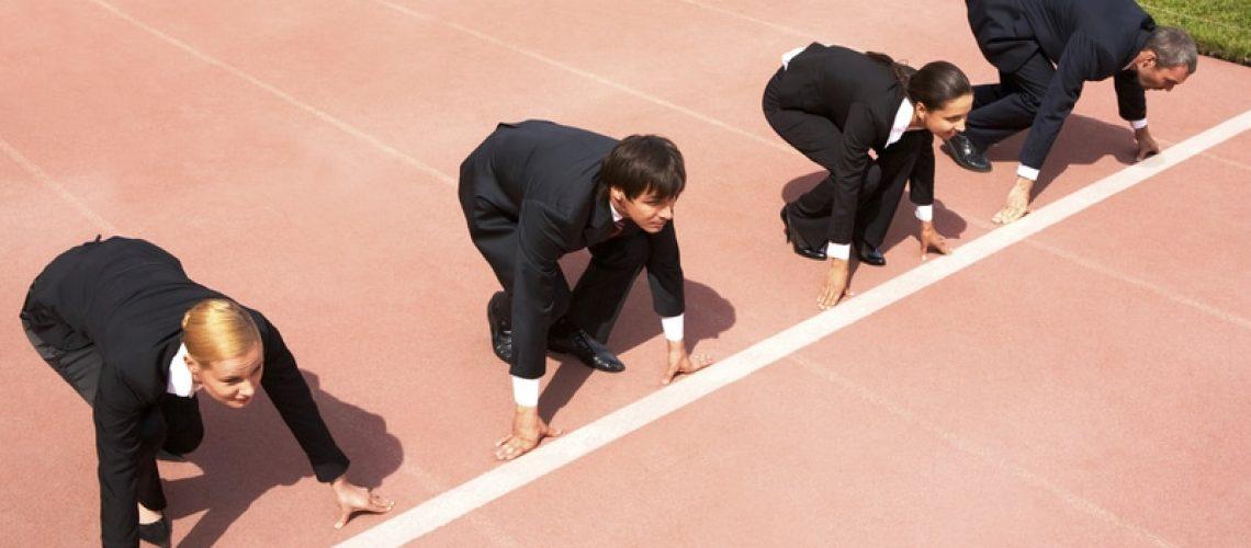 businesspeople ready to race (metaphor)